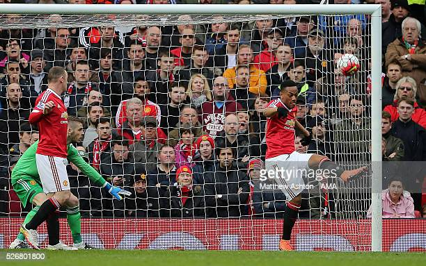 Anthony Martial of Manchester United clears the ball off the goal line during the Barclays Premier League match between Manchester United and...