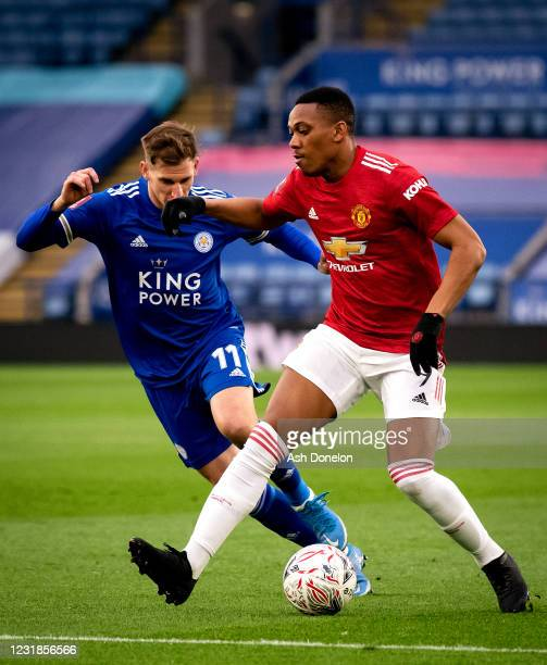 Anthony Martial of Manchester United competes with Marc Albrighton of Leicester City during the Emirates FA Cup Quarter Final match between Leicester...