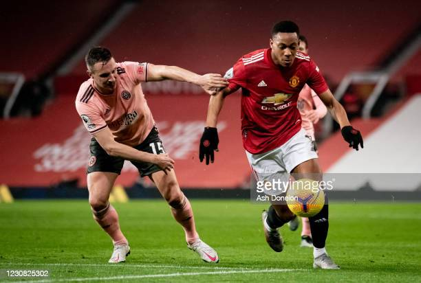 Anthony Martial of Manchester United competes with Phil Jagielka of Sheffield United during the Premier League match between Manchester United and...