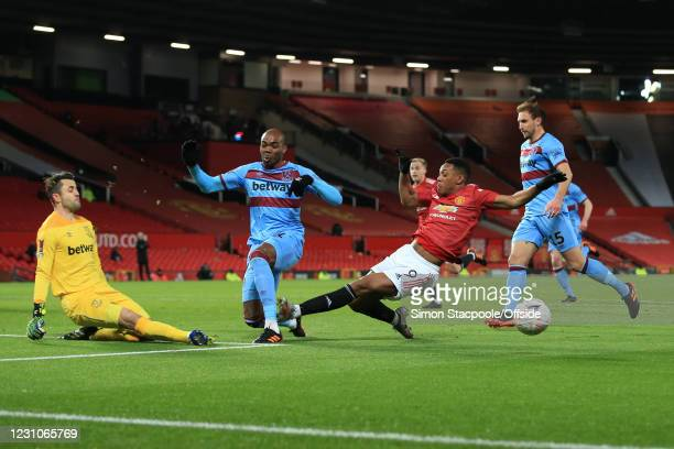 Anthony Martial of Manchester United connects with the ankle of Angelo Ogbonna of West Ham United as Ogbonna blocks his shot during The Emirates FA...