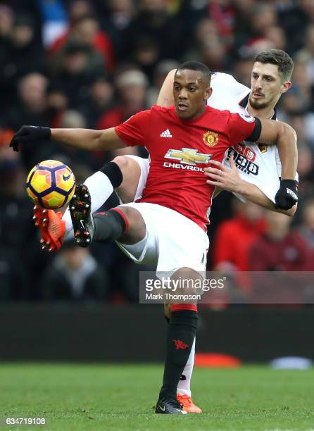 Anthony Martial of Manchester United controls the ball under pressure of Craig Cathcart of Watford during the Premier League match between Manchester...