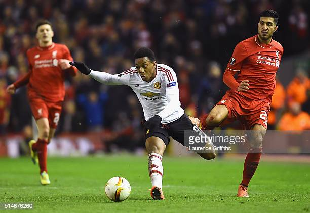 Anthony Martial of Manchester United evades Emre Can of Liverpool during the UEFA Europa League Round of 16 first leg match between Liverpool and...