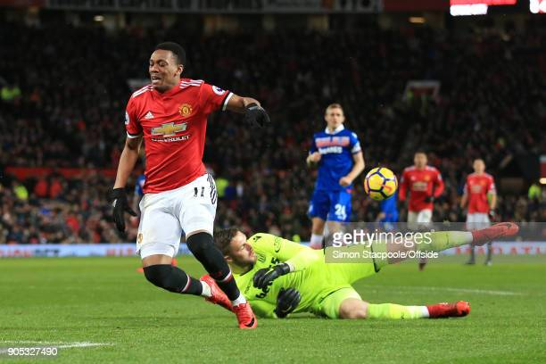 Anthony Martial of Manchester United goes down after jumping over Stoke City goalkeeper Jack Butland during the Premier League match between...