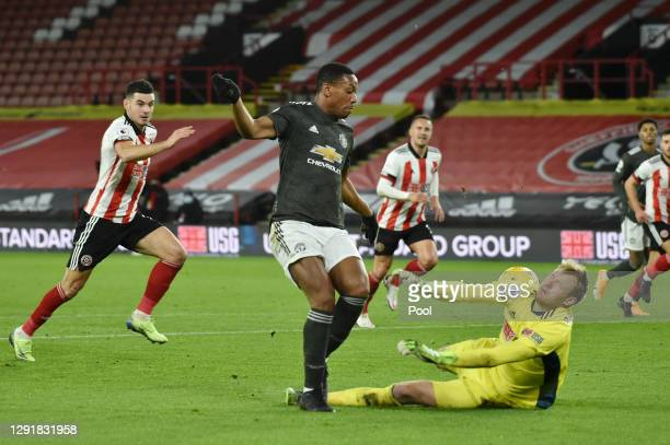 Anthony Martial of Manchester United goes round Aaron Ramsdale of Sheffield United before scoring their sides second goal during the Premier League...