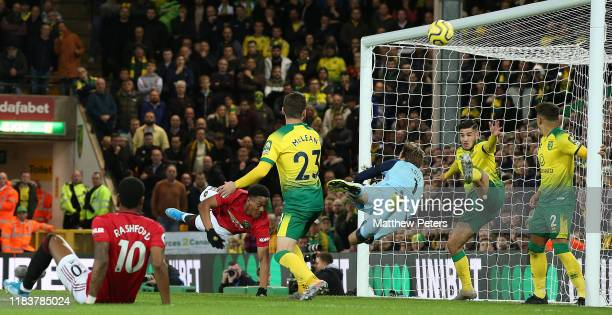 Anthony Martial of Manchester United has a header saved by Tim Krul of Norwich City during the Premier League match between Norwich City and...