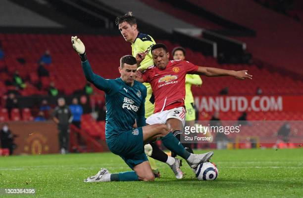 Anthony Martial of Manchester United has a shot saved by Karl Darlow of Newcastle United during the Premier League match between Manchester United...