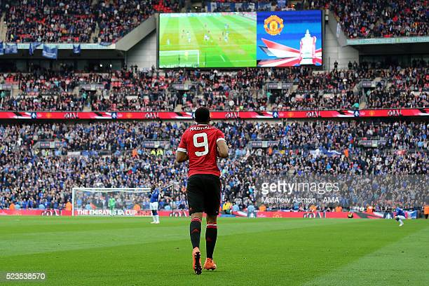 Anthony Martial of Manchester United heads to the centre circle after scoring the winning goal to make the score 12 during the Emirates FA Cup Semi...