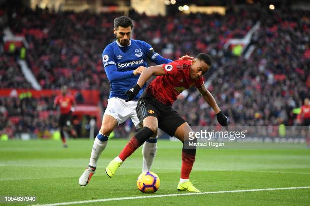 Anthony Martial of Manchester United holds off Andre Gomes of Everton during the Premier League match between Manchester United and Everton FC at Old...