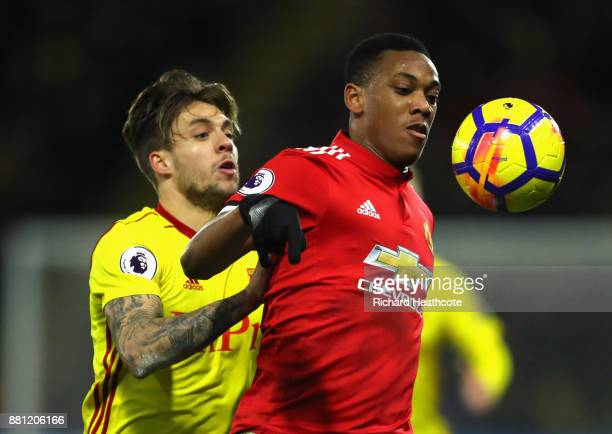Anthony Martial of Manchester United holds off Kiko Femenia of Watford during the Premier League match between Watford and Manchester United at...