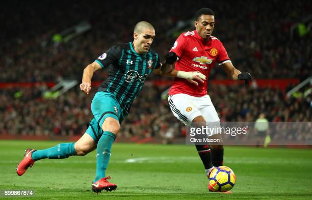 Anthony Martial of Manchester United holds off Oriol Romeu of Southampton during the Premier League match between Manchester United and Southampton...