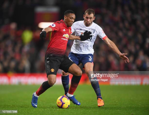 Anthony Martial of Manchester United holds off Steve Cook of AFC Bournemouth during the Premier League match between Manchester United and AFC...