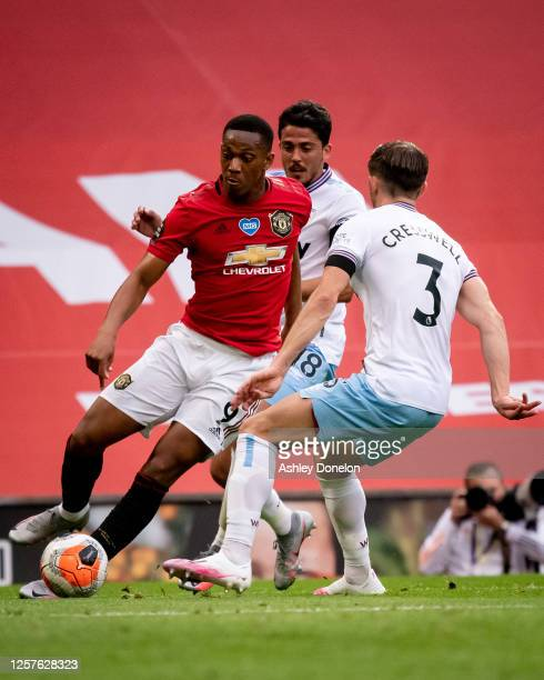 Anthony Martial of Manchester United in action with Aaron Cresswell of West Ham United during the Premier League match between Manchester United and...