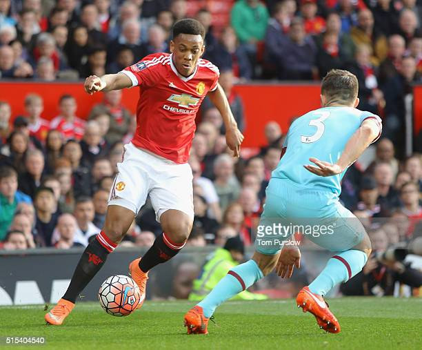 Anthony Martial of Manchester United in action with Aaron Cresswell of West Ham United during the Emirates FA Cup Sixth Round match between...
