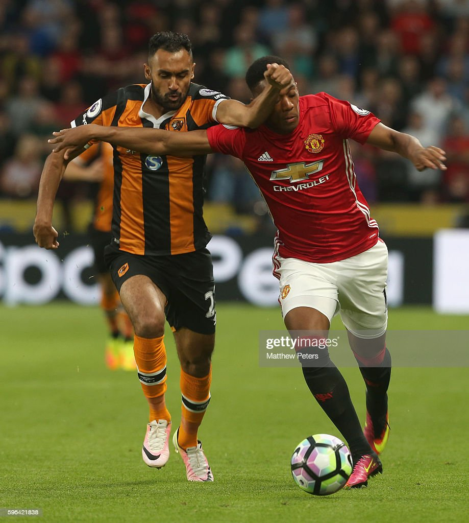 Anthony Martial of Manchester United in action with Ahmed Elmohamady of Hull City during the Premier League match between Manchester United and Hull City at KC Stadium on August 27, 2016 in Hull, England.