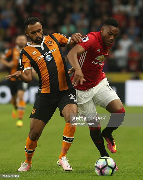 Anthony Martial of Manchester United in action with Ahmed Elmohamady of Hull City during the Premier League match between Manchester United and Hull...