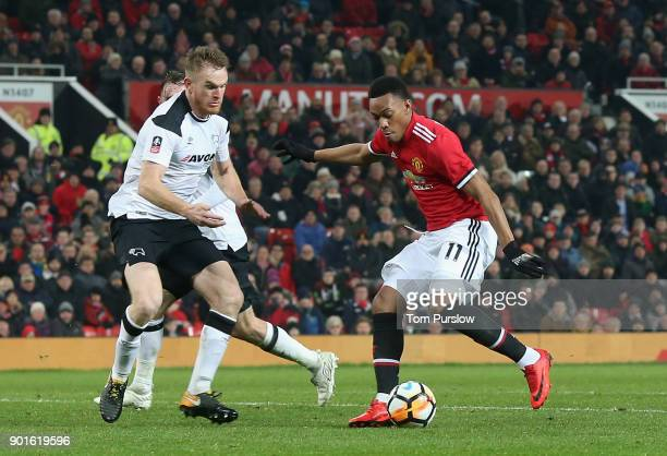 Anthony Martial of Manchester United in action with Alex Pearce of Derby County during the Emirates FA Cup Third Round match between Manchester...
