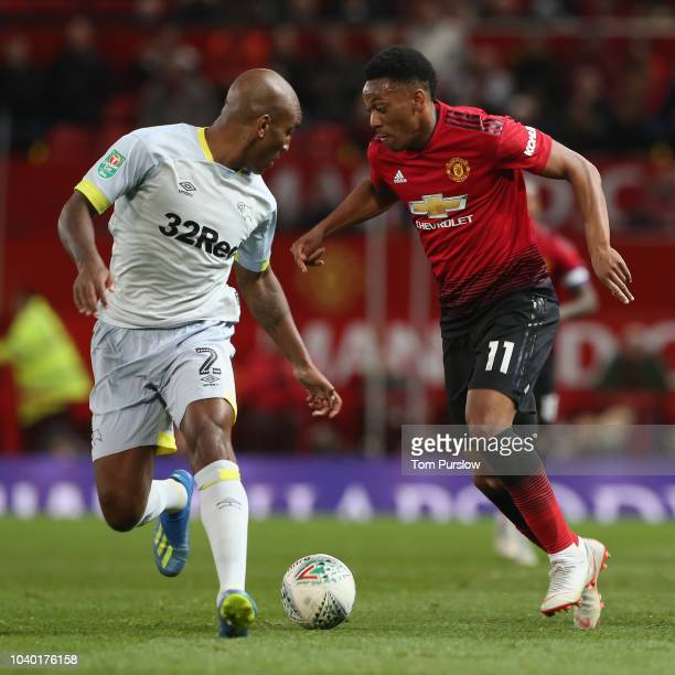 Anthony Martial of Manchester United in action with Andre Wisdom of Derby County during the Carabao Cup Third Round match between Manchester United...