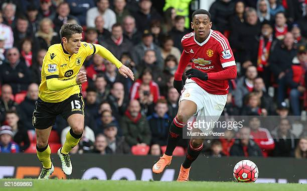 Anthony Martial of Manchester United in action with Ashley Westwood of Aston Villa during the Barclays Premier League match between Manchester United...