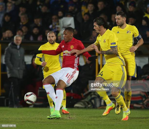 Anthony Martial of Manchester United in action with Cesar Navas of FK Rostov during the UEFA Europa League Round of 16 first leg match between FK...