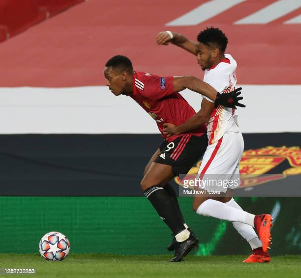 Anthony Martial of Manchester United in action with Christopher Nkunku of RB Leipzig during the UEFA Champions League Group H stage match between...