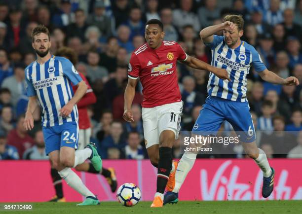 Anthony Martial of Manchester United in action with Dale Stephens of Brighton and Hove Albion during the Premier League match between Brighton and...