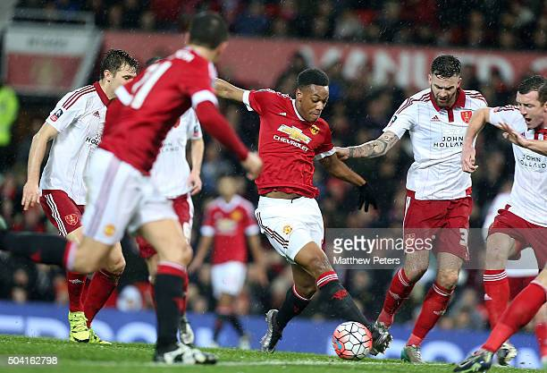 Anthony Martial of Manchester United in action with David Edgar of Sheffield United during the Emirates FA Cup Third round match between Manchester...