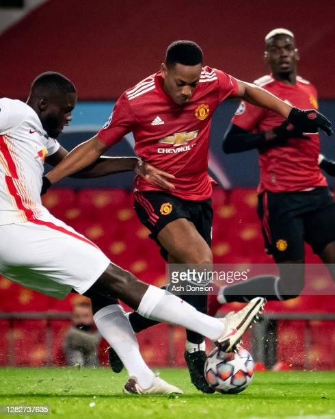 Anthony Martial of Manchester United in action with Dayot Upamecano of RB Leipzig during the UEFA Champions League Group H stage match between...