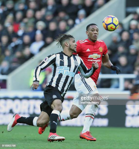 Anthony Martial of Manchester United in action with Deandre Yedlin of Newcastle United during the Premier League match between Newcastle United and...
