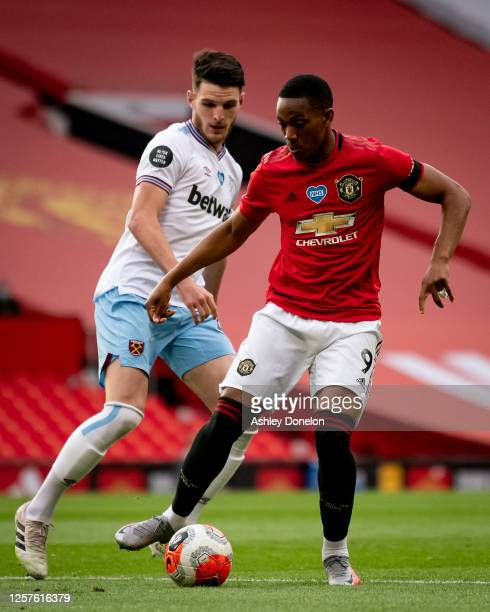 Anthony Martial of Manchester United in action with Declan Rice of West Ham United during the Premier League match between Manchester United and West...