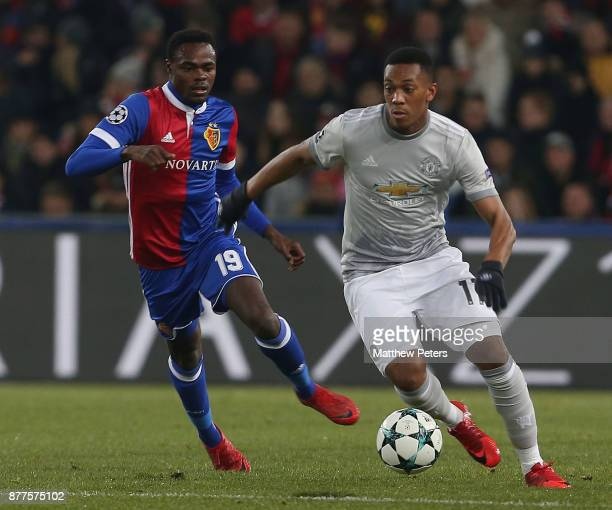 Anthony Martial of Manchester United in action with Dimitri Oberlin of FC Basel during the UEFA Champions League group A match between FC Basel and...