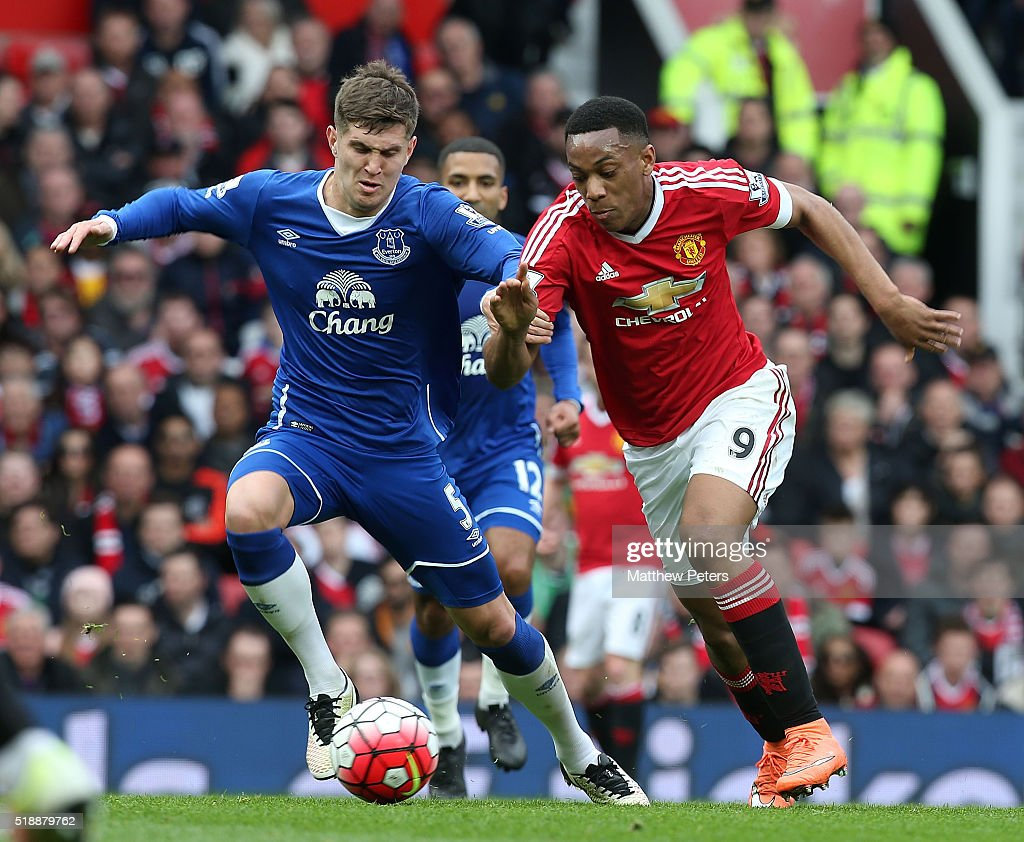 Anthony Martial of Manchester United in action with during John Stones of Everton during the Barclays Premier League match between Manchester United and Everton at Old Trafford on April 3, 2016 in Manchester, England.