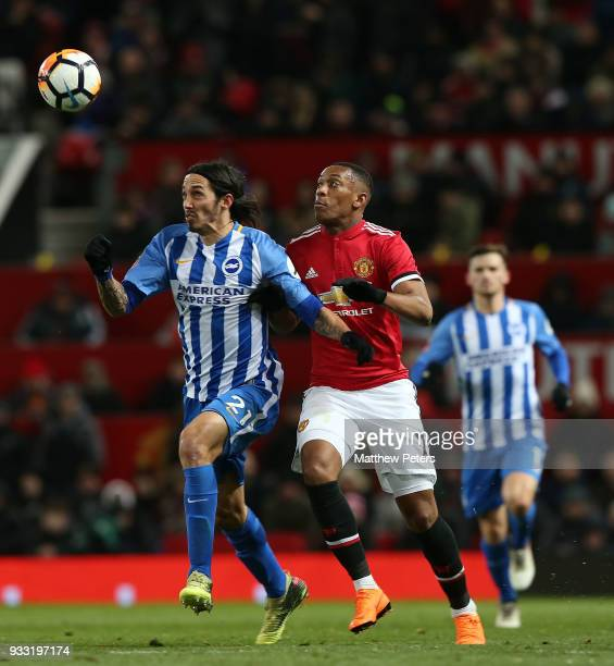 Anthony Martial of Manchester United in action with Ezequiel Schelotto of Brighton Hove Albion during the Emirates FA Cup Quarter Final match between...