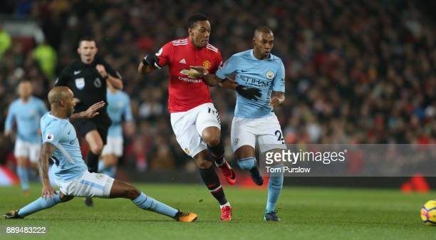 Anthony Martial of Manchester United in action with Fabian Delph and Fernandinho of Manchester City during the Premier League match between...