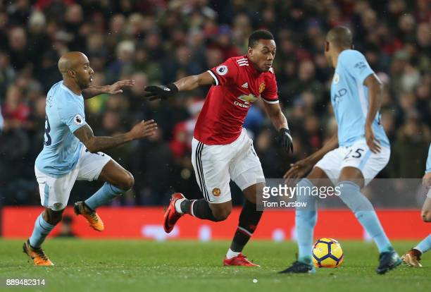 Anthony Martial of Manchester United in action with Fabian Delph of Manchester City during the Premier League match between Manchester United and...