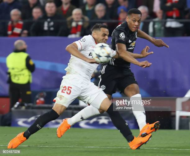 Anthony Martial of Manchester United in action with Gabriel Mercado of Sevilla FC during the UEFA Champions League Round of 16 First Leg match...