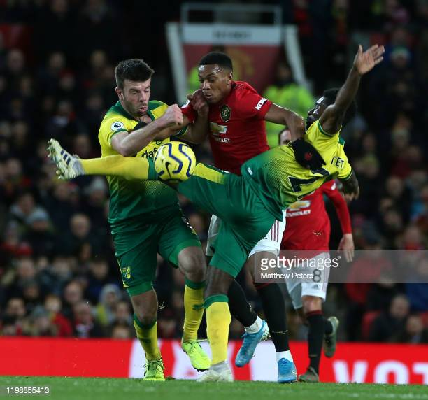 Anthony Martial of Manchester United in action with Grant Hanley and Alexander Tettey of Norwich City during the Premier League match between...