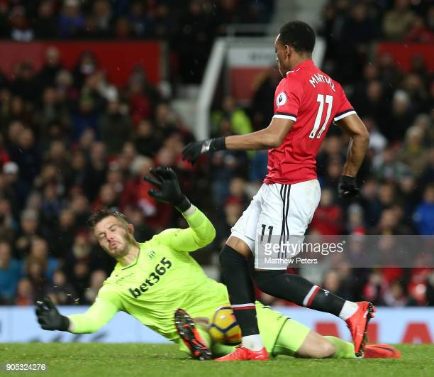 Anthony Martial of Manchester United in action with Jack Butland of Stoke City during the Premier League match between Manchester United and Stoke...