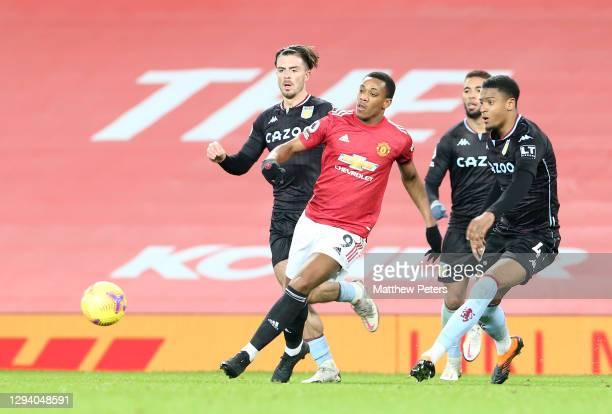 Anthony Martial of Manchester United in action with Jack Grealish and Ezri Konsa of Aston Villa during the Premier League match between Manchester...