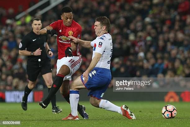 Anthony Martial of Manchester United in action with Jake Buxton of Wigan Athletic during the Emirates FA Cup Fourth Round match between Manchester...