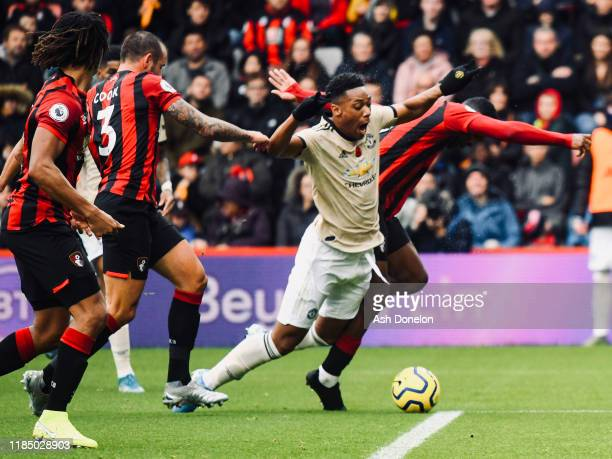 Anthony Martial of Manchester United in action with Jefferson Lerma of AFC Bournemouth during the Premier League match between AFC Bournemouth and...