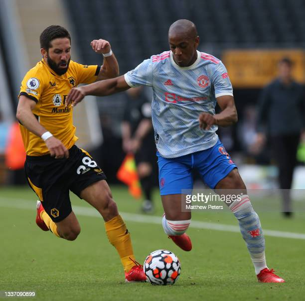 Anthony Martial of Manchester United in action with Joao Moutinho of Wolverhampton Wanderers during the Premier League match between Wolverhampton...