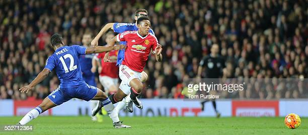 Anthony Martial of Manchester United in action with Jon Obe Mikel of Chelsea during the Barclays Premier League match between Manchester United and...