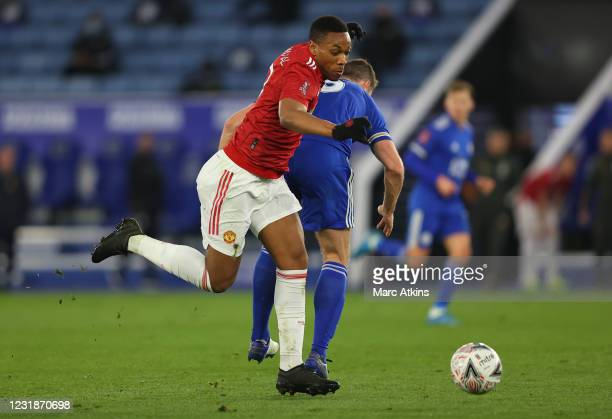 Anthony Martial of Manchester United in action with Jonny Evans of Leicester City during the Emirates FA Cup Quarter Final match between Leicester...