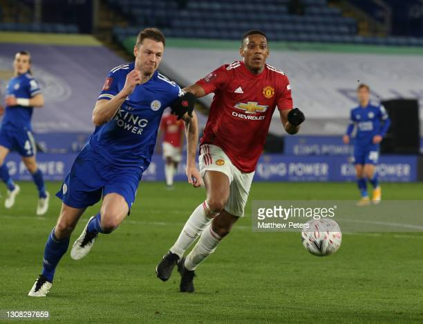 Anthony Martial of Manchester United in action with Jonny Evans of Leicester City during the FA Cup Quarter-Final match between Leicester City and...