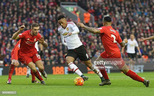 Anthony Martial of Manchester United in action with Jordan Henderson and Nathaniel Clyne of Liverpool during the Barclays Premier League match...