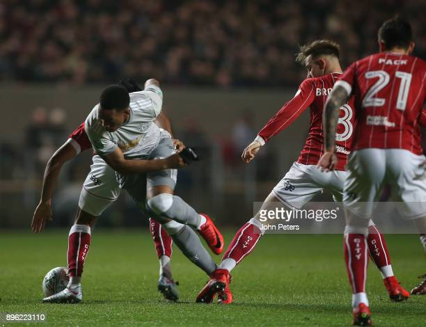 Anthony Martial of Manchester United in action with Josh Brownhill of Bristol City during the Carabao Cup QuarterFinal match between Bristol City and...