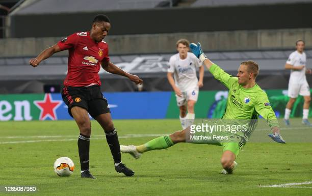 Anthony Martial of Manchester United in action with Karl-Johan Johnsson of FC Kobenhavn during the UEFA Europa League Quarter Final between...