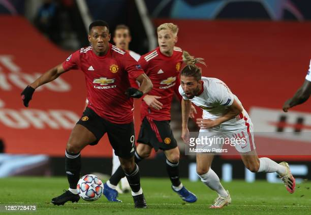 Anthony Martial of Manchester United in action with Kevin Kampl of RB Leipzig during the UEFA Champions League Group H stage match between Manchester...