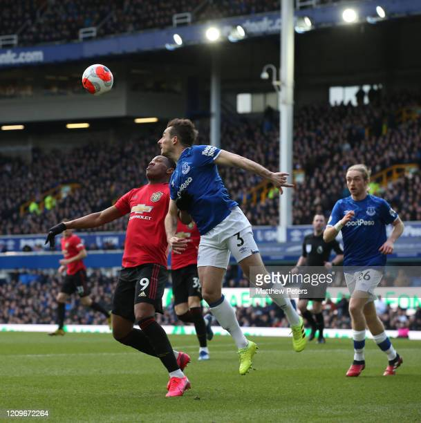 Anthony Martial of Manchester United in action with Leighton Baines of Everton during the Premier League match between Everton FC and Manchester...