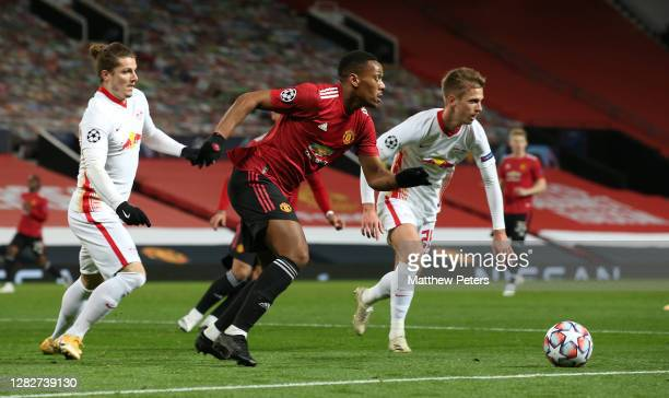 Anthony Martial of Manchester United in action with Marcel Sabitzer of RB Leipzig during the UEFA Champions League Group H stage match between...
